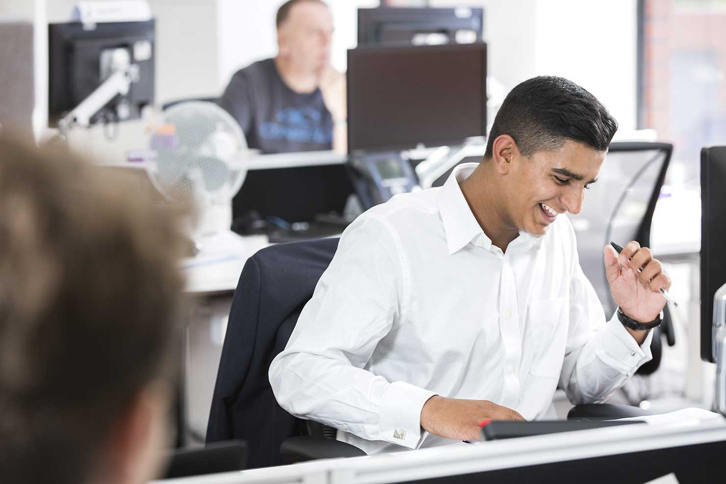 A work experience team member at a computer
